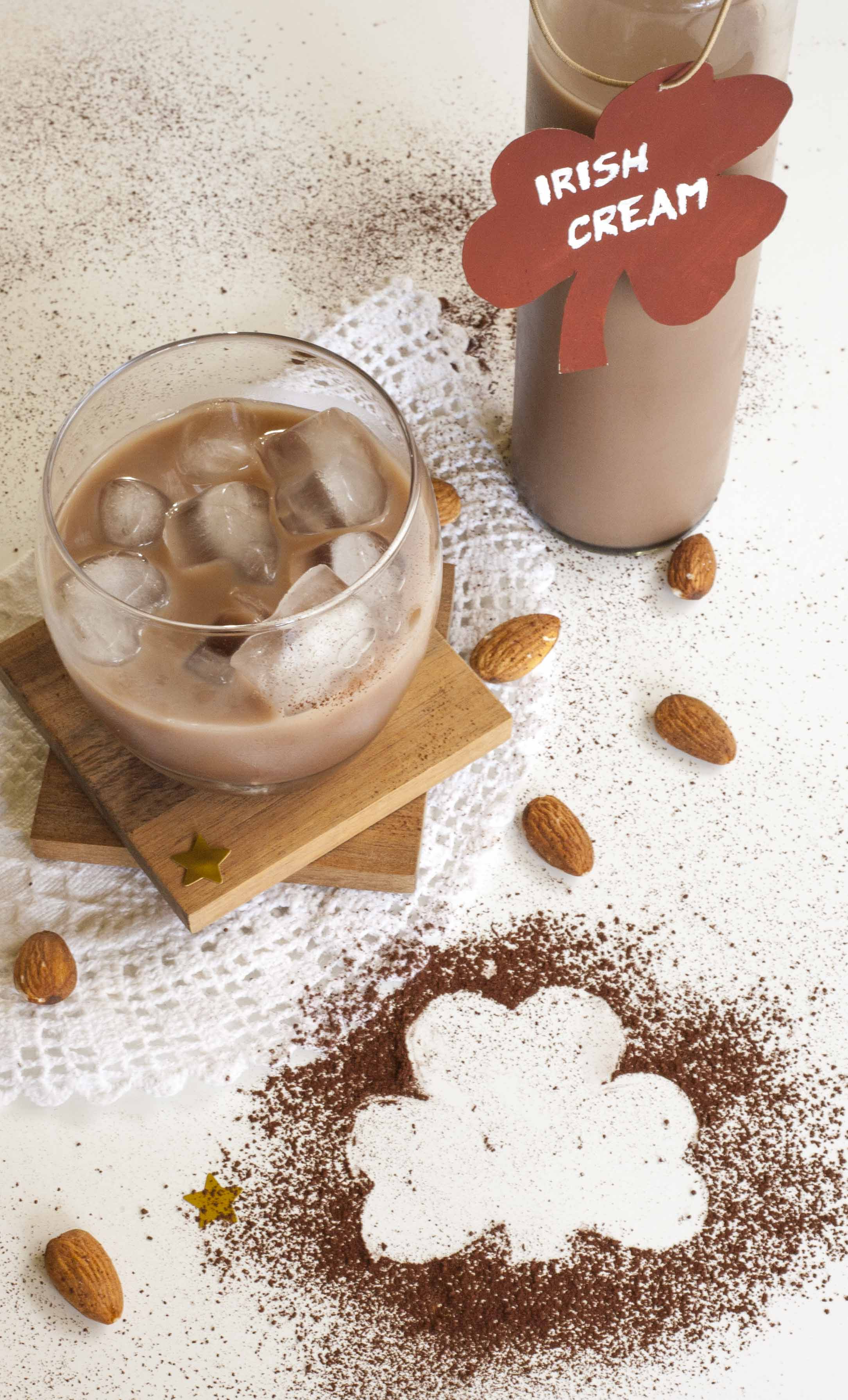 A glass and a bottle full of Vegan Baileys made of coffee, Irish whiskey, cane sugar, almond milk, and a bit of vanilla extract and cocoa powder.