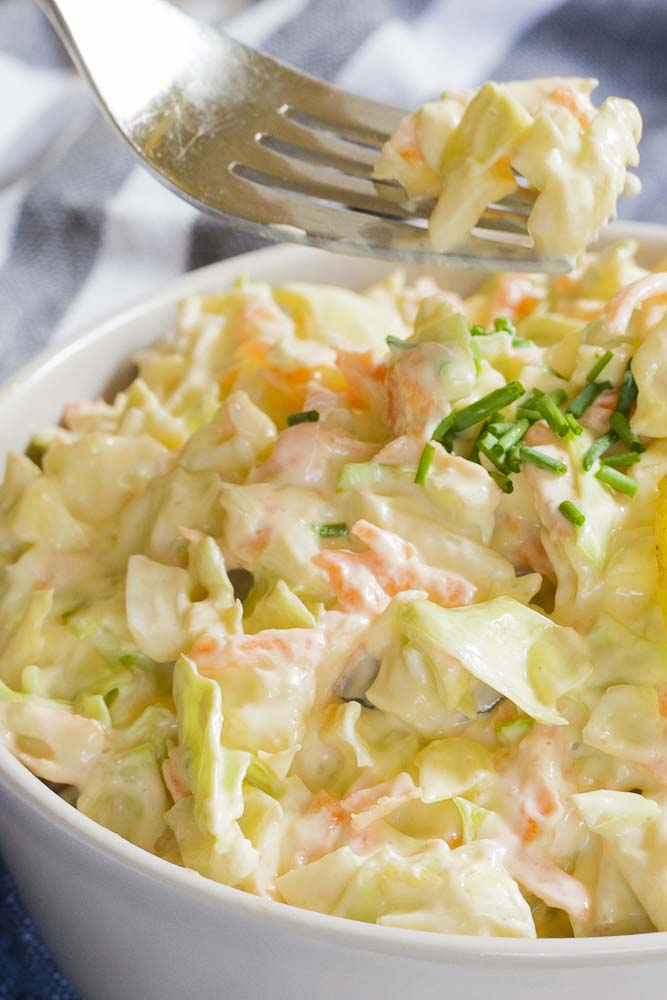 close-up of vegan coleslaw and a fork with a small bite