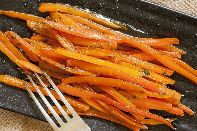 Close-up of maple glazed sauteed julienne carrots.