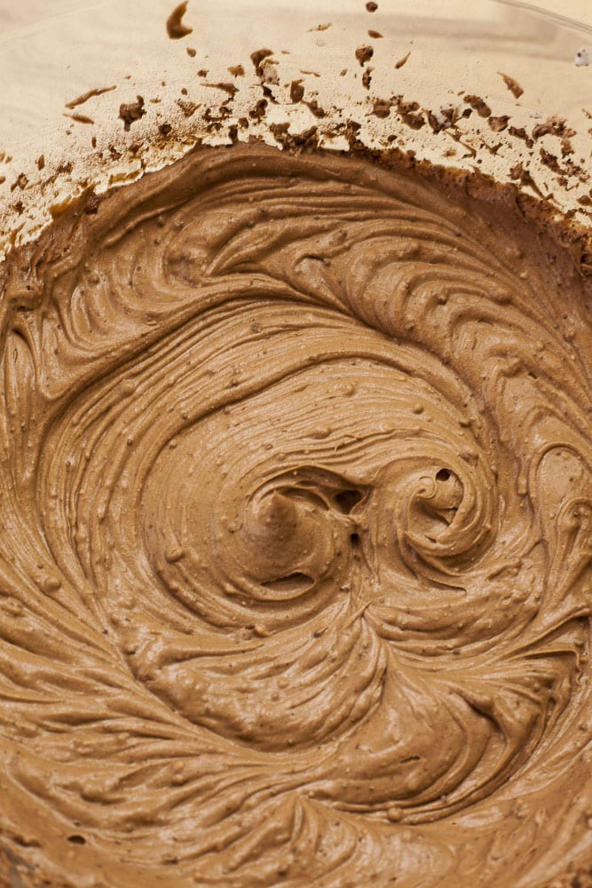 Close-up of a bowl full of vegan chocolate frosting after it was whipped