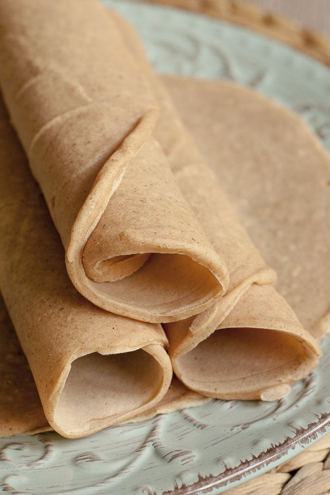 Close-up of all 4 grain-free tortillas rolled up empty.