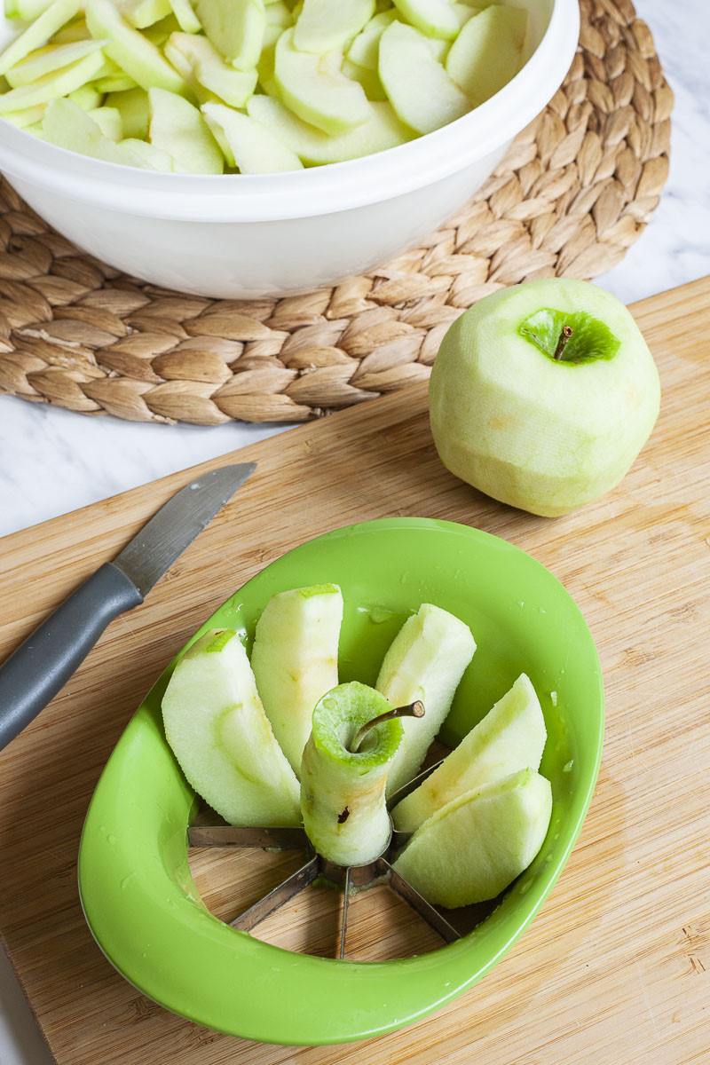 Apple slices in an apple corer.