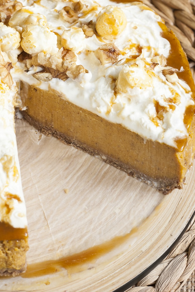 Pumpkin cheesecake with gingerbread pie crust sliced so you can see how the dough looks like in action