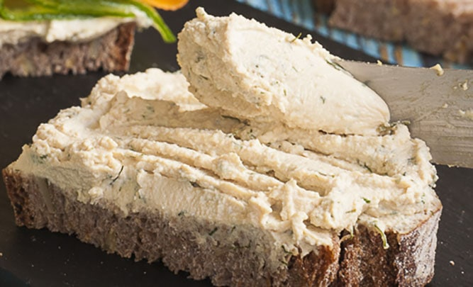 Close-up of a slice of bread topped with tofu cream cheese