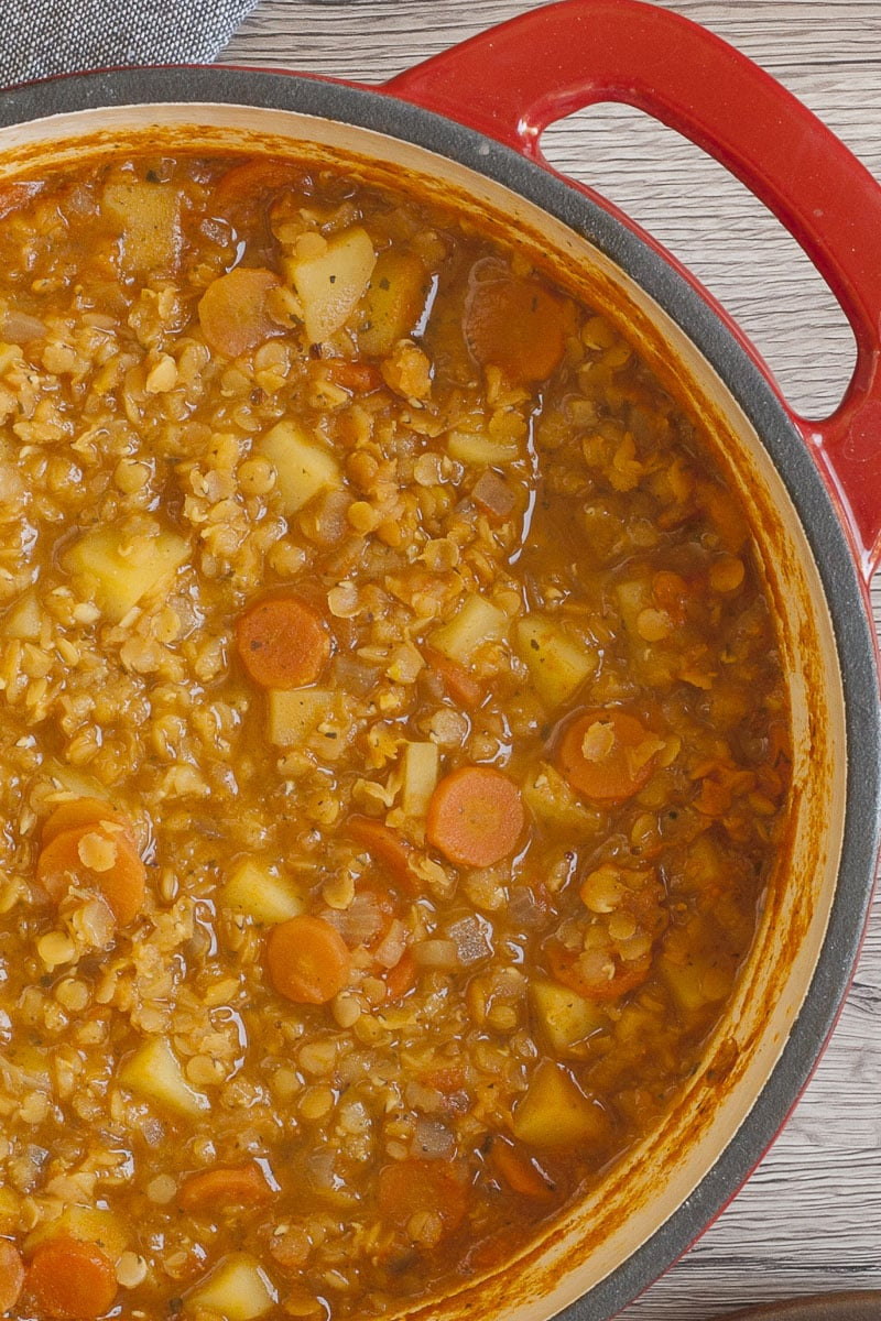 Red Dutch Oven from above with vegan red lentil soup