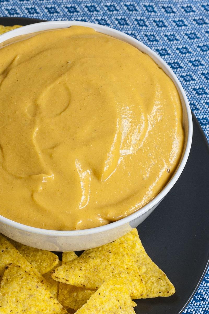 White bowl of nut-free nacho cheese dip
