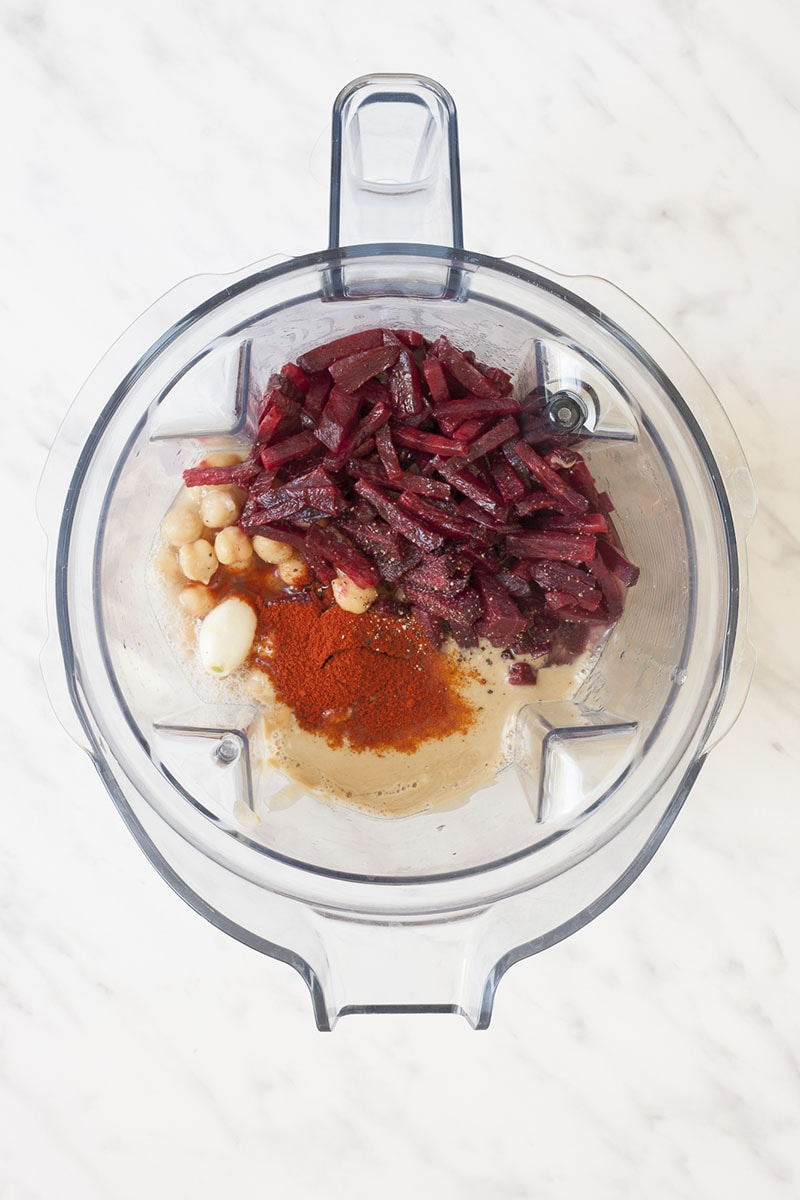 Blender from above with the ingredients of roasted beetroot hummus