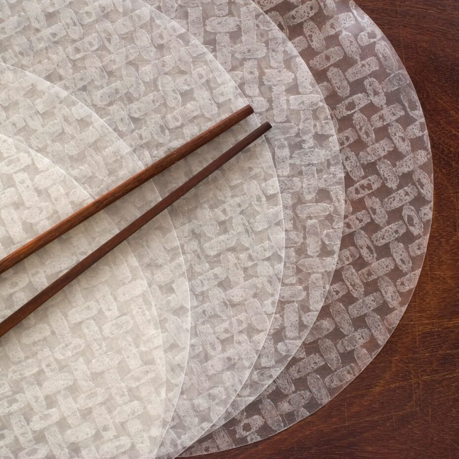 A couple of round rice papers on a wooden surface